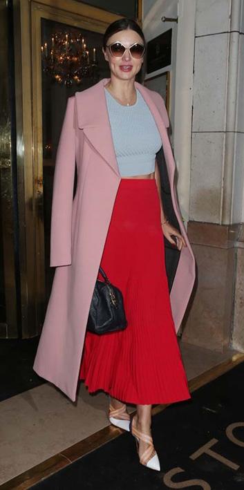 red-midi-skirt-blue-light-top-crop-pink-light-jacket-coat-sun-bun-black-bag-mirandakerr-wear-outfit-spring-summer-white-shoe-pumps-hairr-classic-dinner.jpg