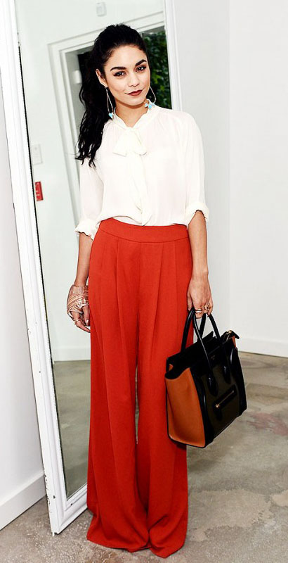 orange-wideleg-pants-white-top-blouse-tie-earrings-pony-cognac-bag-vanessahudgens-fall-winter-brun-work.jpg