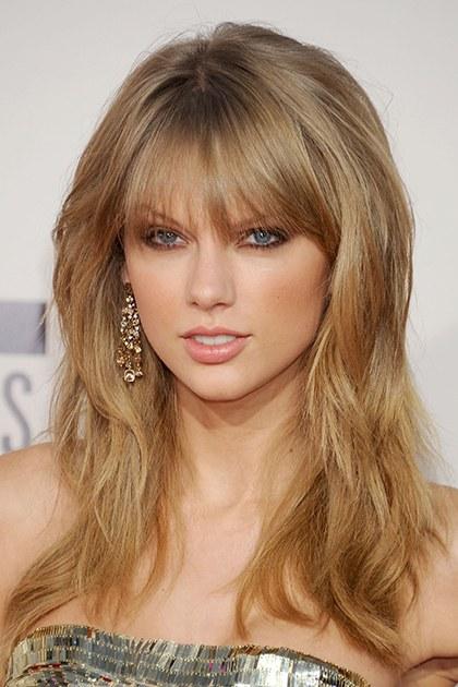 hair-taylorswift-blonde-makeup-bangs-layers-earrings.jpg