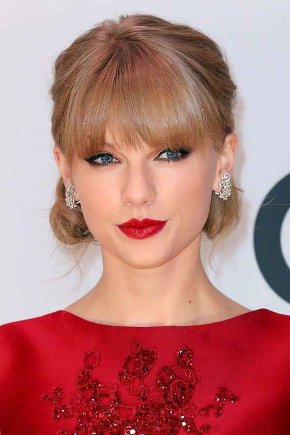 hair-taylorswift-blonde-makeup-bangs-updo-red-lips-studs.jpg