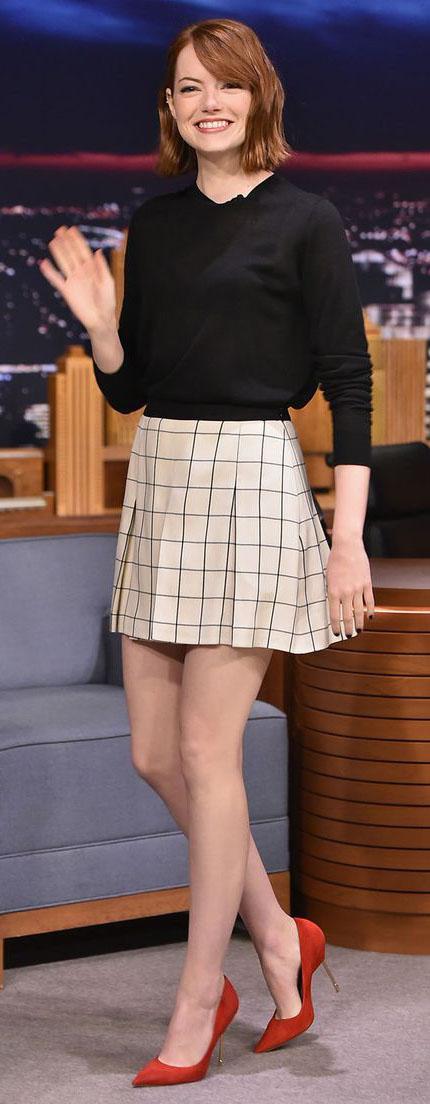 white-mini-skirt-black-sweater-emmastone-wear-style-fashion-fall-winter-windowpane-red-shoe-pumps-late-night-pleat-hairr-dinner.jpg