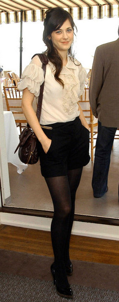 celebrity-retro-style-type-fashion-white-top-blouse-ruffle-black-bag-black-shoe-pumps-black-shorts-black-tights-zooeydeschanel-brun-fall-winter-dinner.jpg