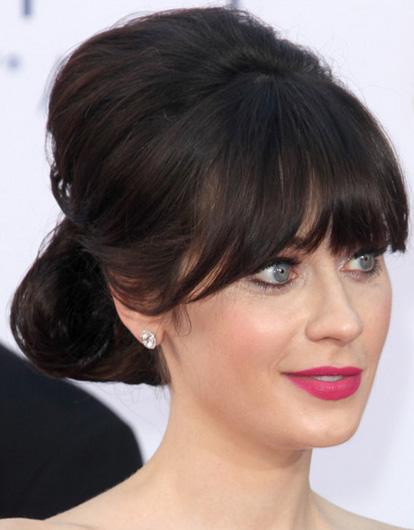 hair-zooeydeschanel-brun-makeup-updo-bun-bangs.jpg