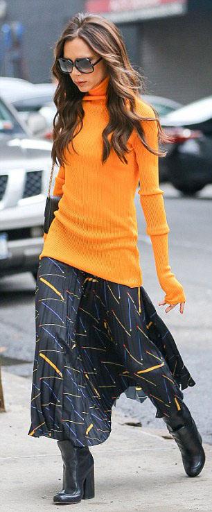 black-midi-skirt-print-orange-sweater-turtleneck-black-bag-black-shoe-booties-victoriabeckham-brun-fall-winter-lunch.jpg