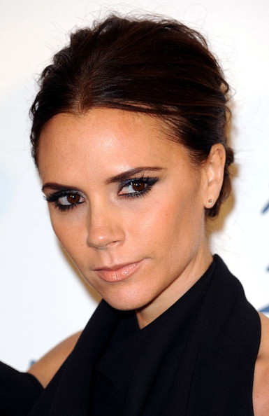 hair-makeup-victoriabeckham-brun-updo-messy-eyeliner-black.jpg