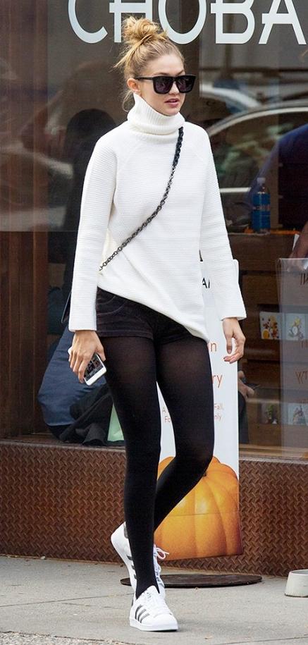 black-shorts-white-sweater-howtowear-fashion-style-outfit-fall-winter-turtleneck-black-bag-bun-sun-white-shoe-sneakers-black-tights-gigihadid-blonde-weekend.jpg