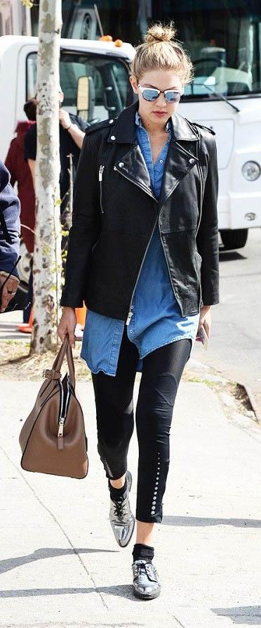 black-leggings-blue-med-top-collared-shirt-black-jacket-moto-tan-bag-hand-gigihadid-chambray-wear-outfit-fashion-fall-winter-gray-shoe-brogues-celebrity-bun-sun-blonde-black-lunch.jpg