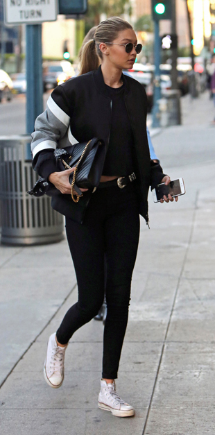 black-leggings-black-tee-black-jacket-bomber-pony-sun-belt-black-bag-gigihadid-wear-outfit-fashion-fall-winter-white-shoe-sneakers-blonde-black-lunch.jpg
