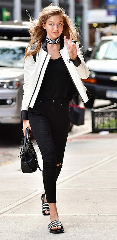 black-skinny-jeans-black-tee-howtowear-style-fashion-fall-winter-black-shoe-sandals-slides-white-jacket-bomber-black-bag-gigihadid-choker-street-blonde-lunch.jpg