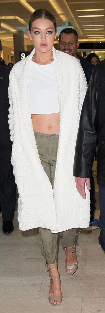 green-olive-joggers-pants-white-top-crop-white-cardiganl-bun-tan-shoe-sandalh-wear-style-fashion-spring-summer-gigihadid-celebrity-blonde-celebrity-dinner.jpg