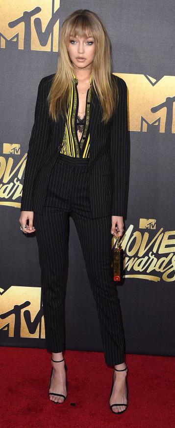 black-slim-pants-yellow-top-blouse-howtowear-black-shoe-sandalh-black-jacket-blazer-black-bralette-gigihadid-celebritymtv-fall-winter-blonde-dinner.jpg