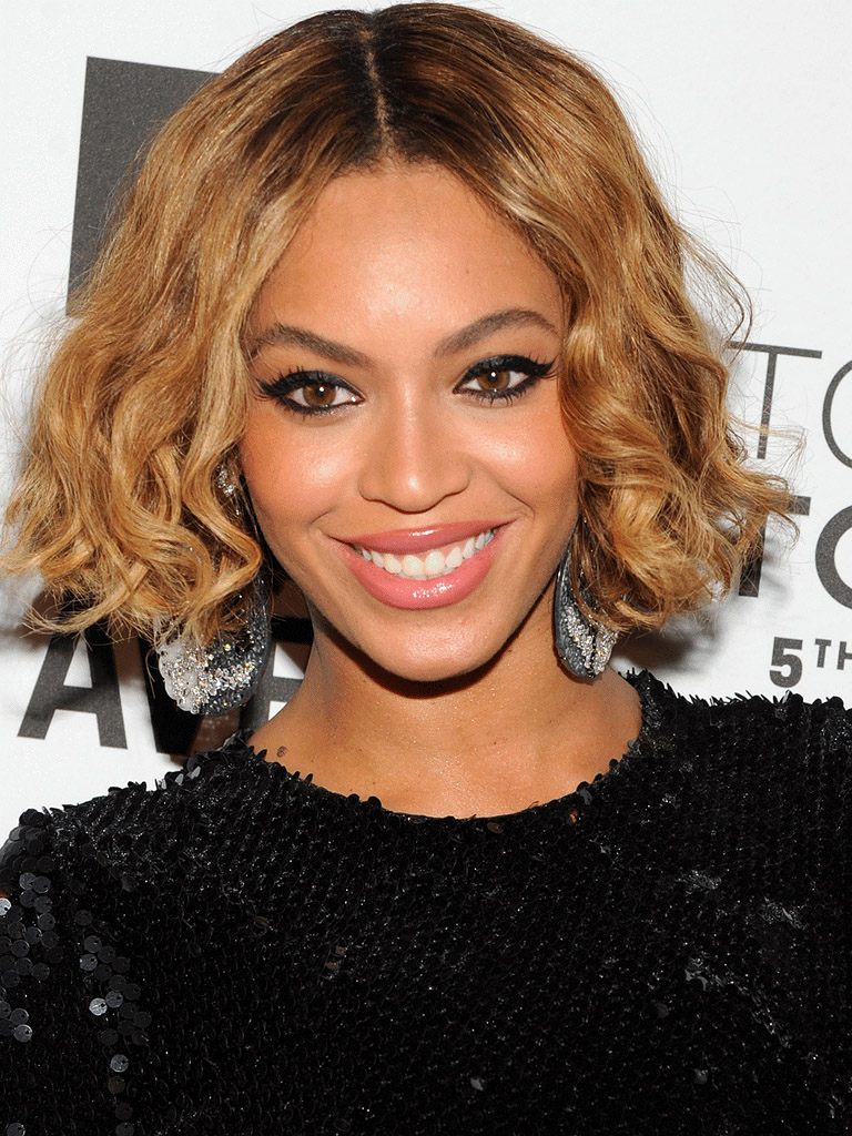 what-to-wear-oval-face-shape-style-haircut-sunglasses-hat-earrings-jewelry-beyonce-bob-curly-eyeliner.jpg