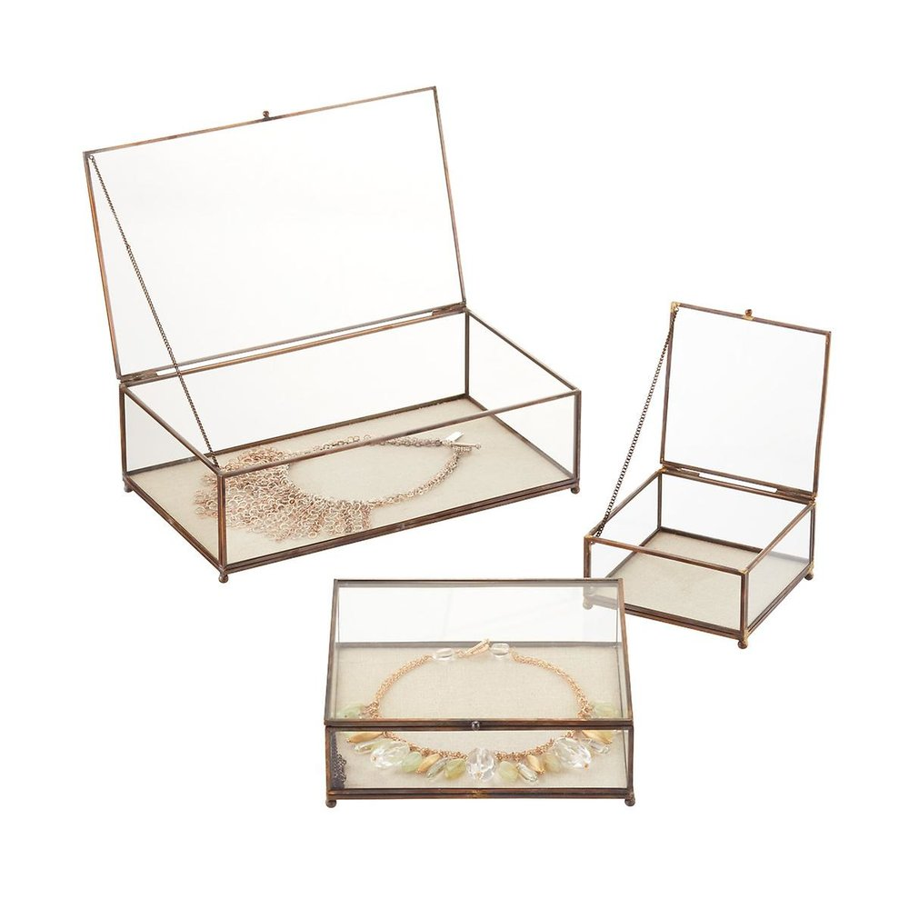 Antique Brass Jewelry Boxes, $15-$30 at The Container Store - These pretty glass boxes are beautiful for a visible place in your dressing area - and they'd work well for watches or sunglasses!