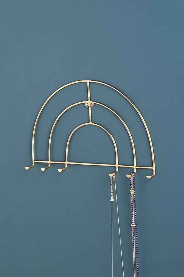 Gateway Jewelry Hook Rack, $28 at Anthropologie - This pretty wall hanger can hold a couple necklaces on each hook.
