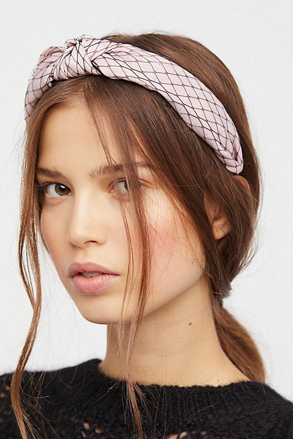 medium-how-to-style-hair-accessories-headbands-hairstyles-ways-to-wear-freepeople-messy-printed-ponytail.jpg