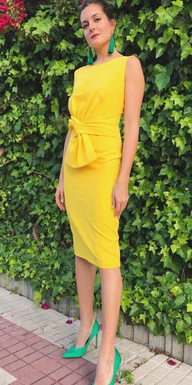 what-to-wear-for-a-summer-wedding-guest-outfit-yellow-dress-shift-bodycon-earrings-hairr-bun-green-shoe-pumps-dinner.jpg