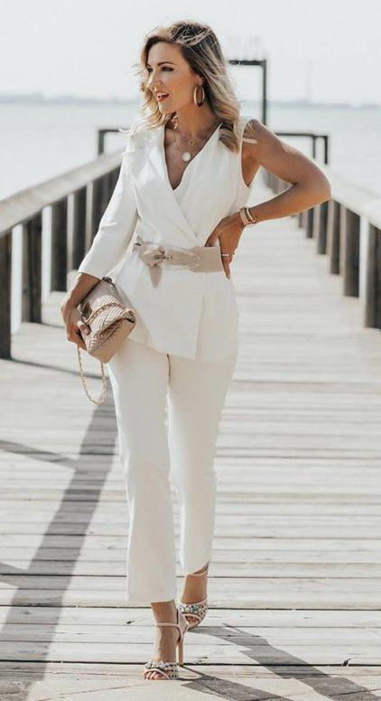 what-to-wear-for-a-spring-wedding-guest-outfit-white-slim-pants-wide-belt-tonal-necklace-blonde-suit-tan-shoe-sandalh-white-jacket-blazer-dinner.jpg