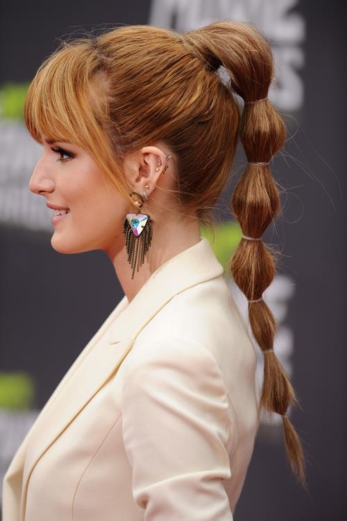 wedding-guest-hair-bubble-ponytail-updo-style-beauty-bellathorne-updo-bangs-long.jpg