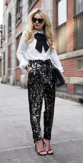 what-to-wear-for-a-winter-wedding-guest-outfit-black-joggers-pants-white-top-blouse-bow-blonde-black-bag-black-shoe-sandalh-sequin-dinner.jpg