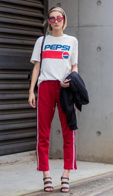red-slim-pants-trackpants-white-graphic-tee-sun-black-shoe-sandalh-blonde-bob-fall-winter-lunch.jpg
