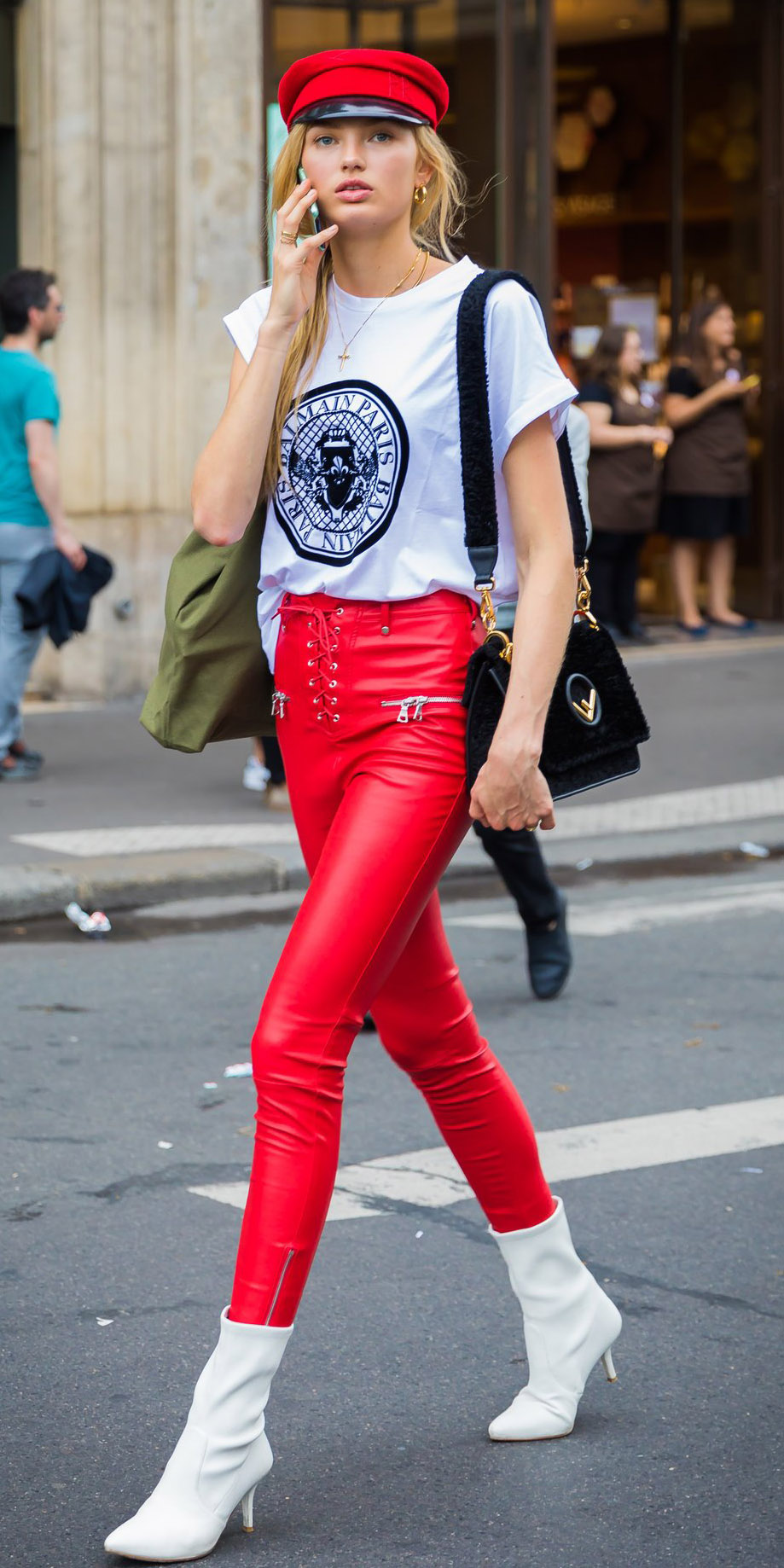how-to-style-red-skinny-jeans-leather-white-graphic-tee-blonde-newsboy-cap-hat-black-bag-white-shoe-booties-fall-winter-fashion-lunch.jpg