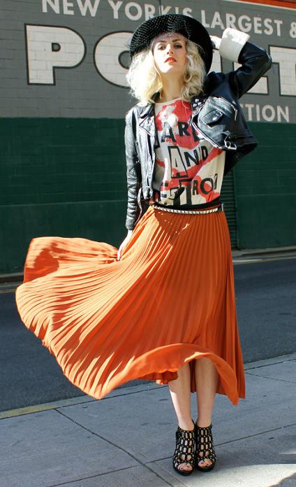 orange-midi-skirt-pleated-white-graphic-tee-black-jacket-moto-hat-blonde-black-shoe-sandalh-fall-winter-lunch.jpg