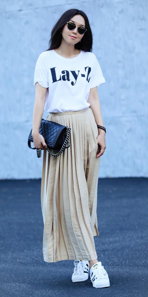 tan-midi-skirt-white-shoe-sneakers-white-graphic-tee-brun-sun-black-bag-pleated-spring-summer-weekend.jpg