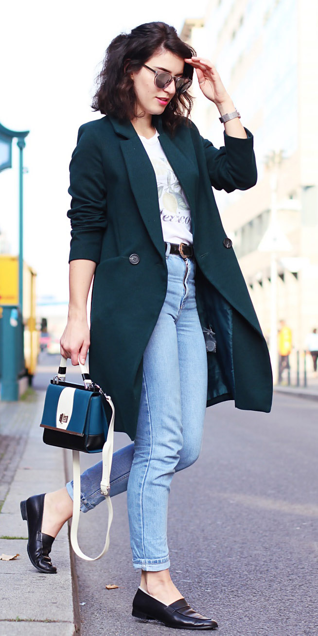 blue-light-skinny-jeans-white-graphic-tee-belt-blue-bag-black-shoe-loafers-sun-green-dark-jacket-coat-fall-winter-brun-lunch.jpg