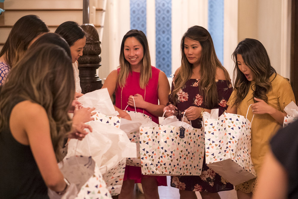Catherine's best friends and bridesmaids open their gifts.