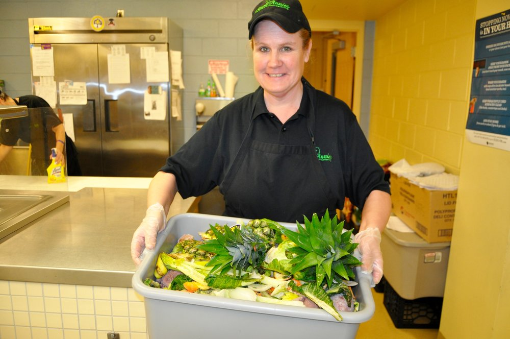 Annie Bercaw of Apple Annie's Catering shows the food waste scraps that can be composted.