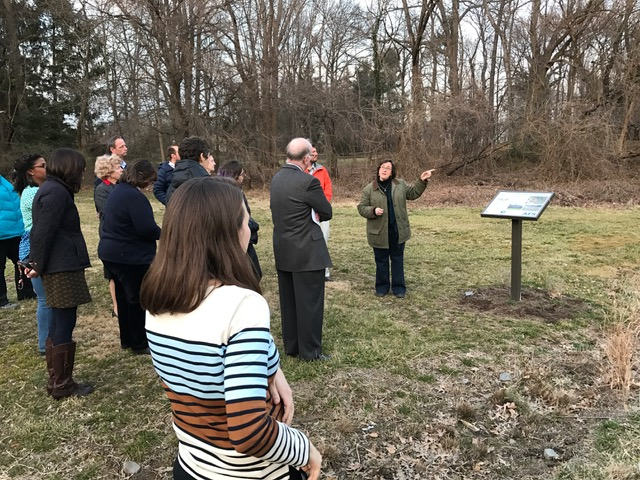 At   PAISBOA's spring Sustainability Group meeting, Rosanne Mistretta, Director of Abington Friends School's Center for Experiential Learning, leads a tour of sustainable features on AFS's campus.