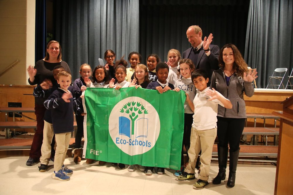 SCH Academy students celebrate the Green Flag award with Steve Druggan, Head of School, Ellen Kruger, Chair of the Green Task Force and Holly Shields of National Wildlife Federation.
