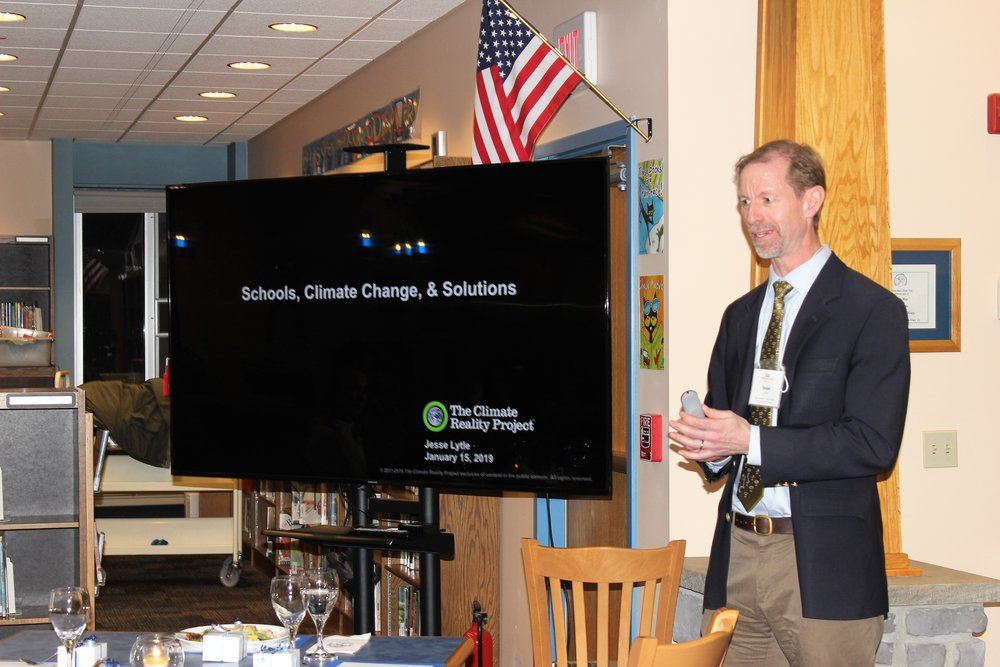 Jesse Lytle speaks to PAISBOA Sustainability Group members at Ancillae-Assumpta Academy about climate change.