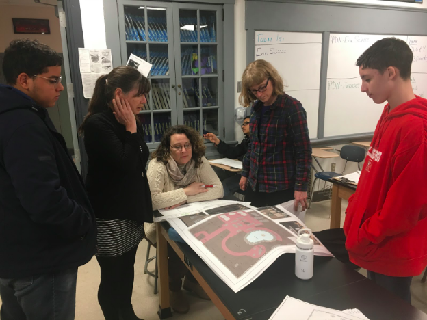 RHS's Green Committee of faculty and students review design drawings by Structure Green's Ann Sellers (pictured second from left)