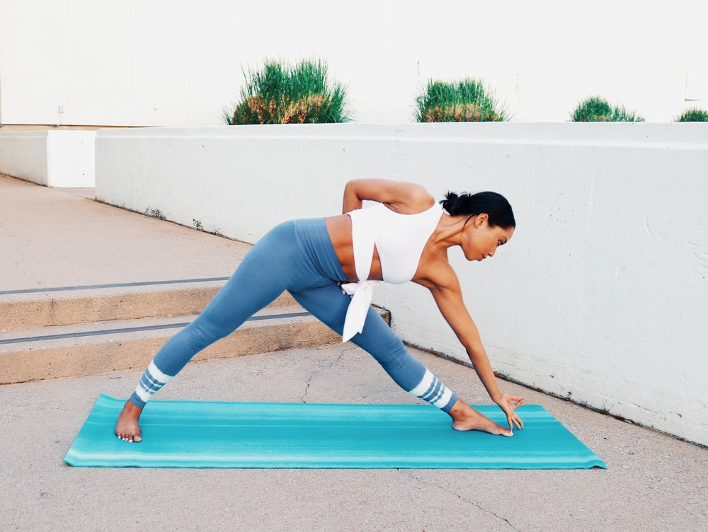 """Triangle Pose - In continuation of my womb awakening, I'm incorporating my """"womb awakening""""meditation with some yoga poses to help me fully tap into this energy center and clear any negativities. I've started with triangle to work my obliques, lengthening my torso."""