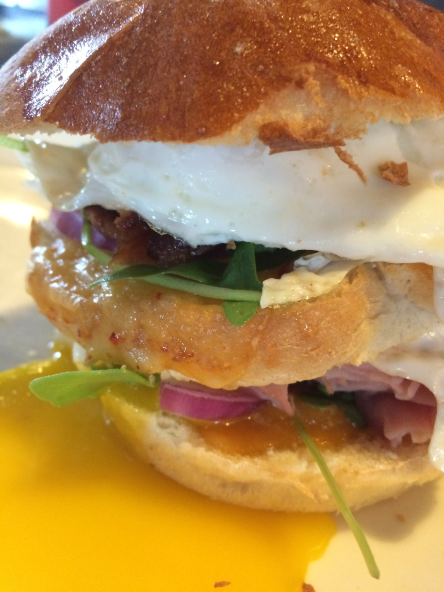 Brunch: Hot Mess Double Decker Egg Sandwich Double-cut brioche roll stuffed with 2 fried eggs, pecanwood-smoked bacon, chipotle gouda, smoked ham and cheddar. You'll never be the same -- but you will return to brunch up with us!