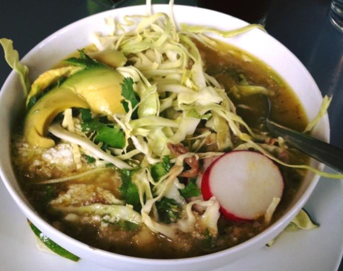 Posole Thursdays Alternating every week between red and green Posole. Pork and hominy in either a serrano and green chili broth, or a guajillo chili broth. Topped with cabbage, radish, avocado, Cotija, cilantro and lime..