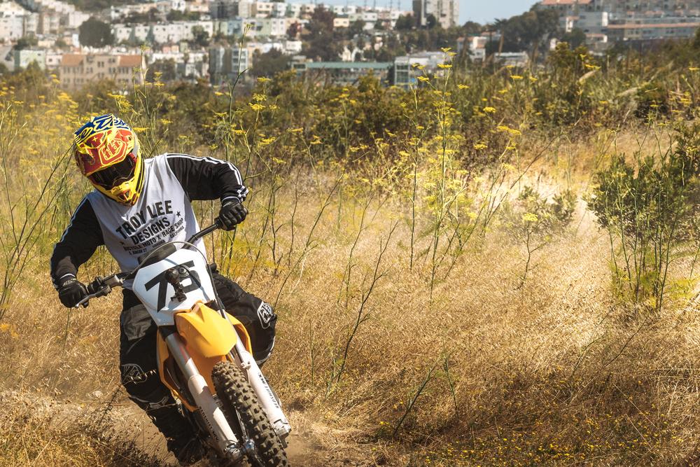 The Redshift MX Dirt Bike Cuts Through Fields in California