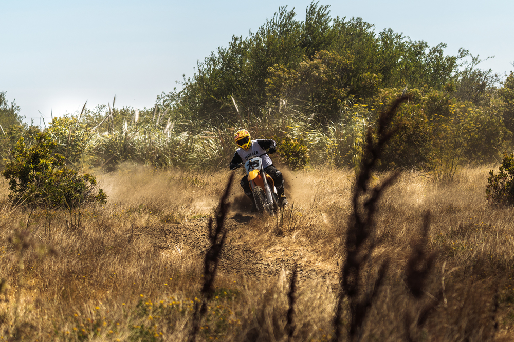 Jeff Ward Cutting Across a Field on the Redshift MX