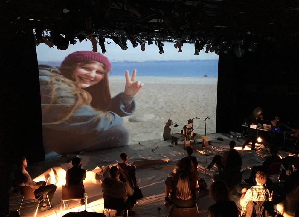 Photographs from June 2017 performance: projected image of Ayse Deniz Karacagil, tortoise stage, paper floor, audience.