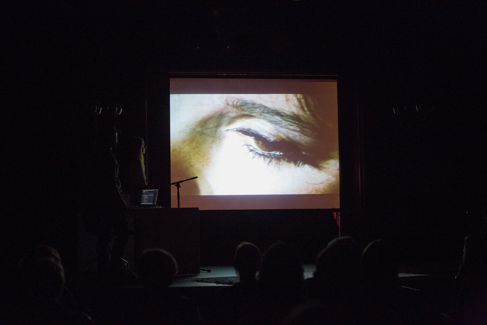 projection screen showing opening of Peter Whitehead's The Fall