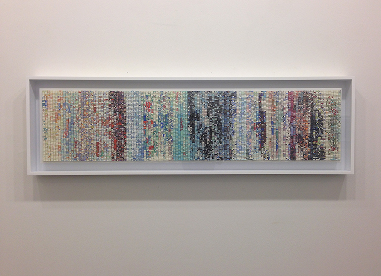 "Shredded: Timeline 3, 2016. Paper collage on wood panel, W48"" x H12"" x 1.5"". Framed W51.75"" x H15.5"" x D3""."