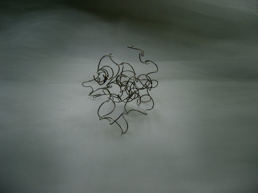 "Invisible 2, 2005, wire and glass, approx. 3"" x 4"" x 4""."