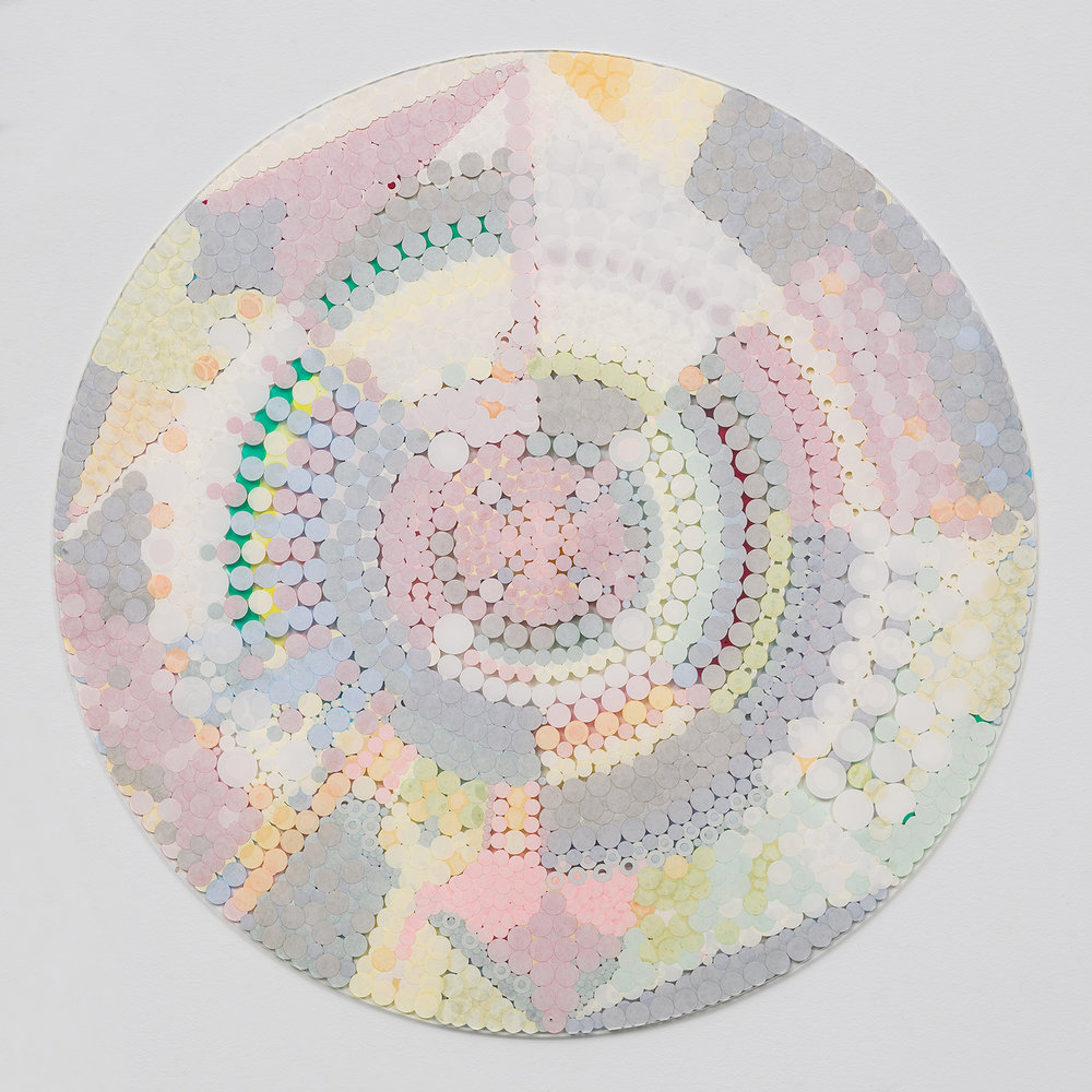 "Fusion Mandala 1,  2011, color coded labels collage on Plexi, 30"" diameter."