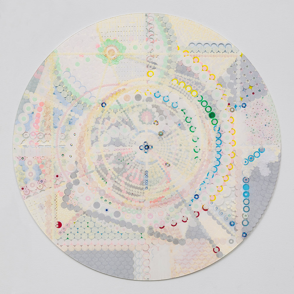 "Fusion Mandala 2, 2014, color coded labels collage on Plexi, 30"" diameter."