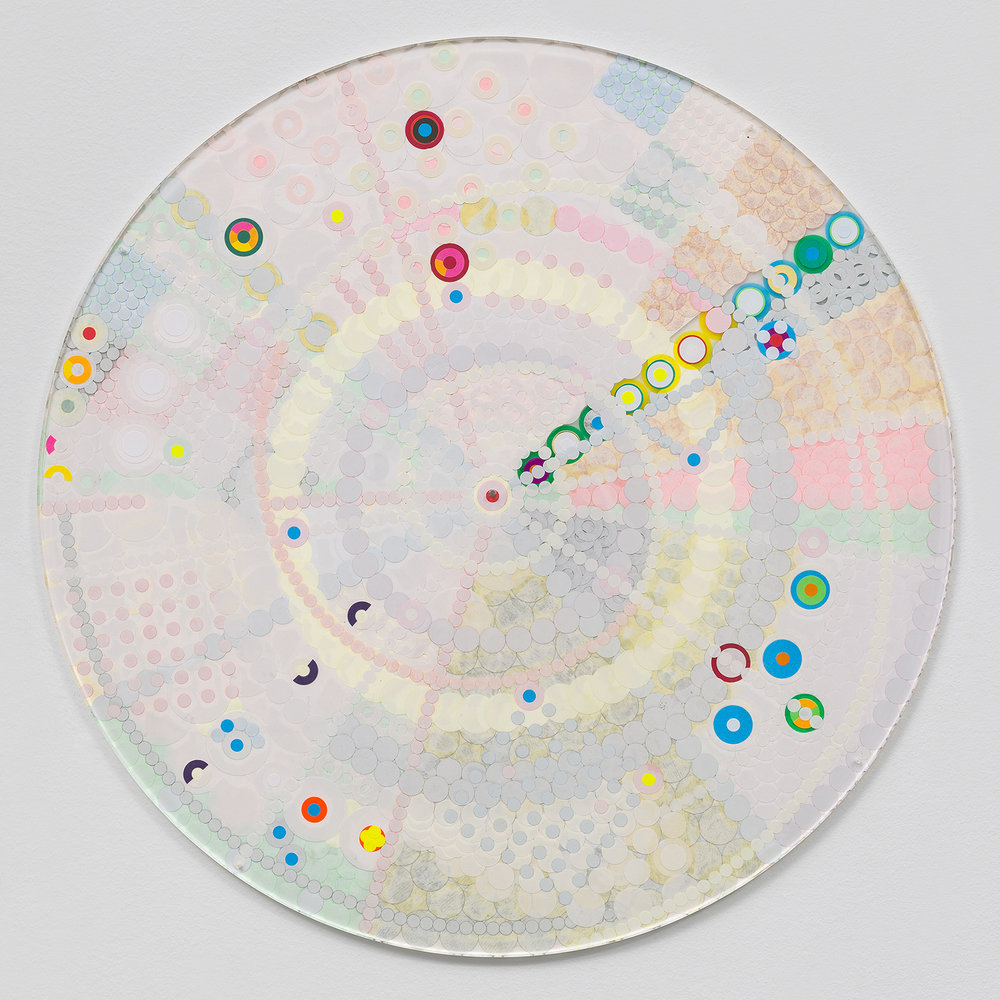 "Fusion Mandala 3, 2014, color coded labels collage on Plexi, 17"" diameter."