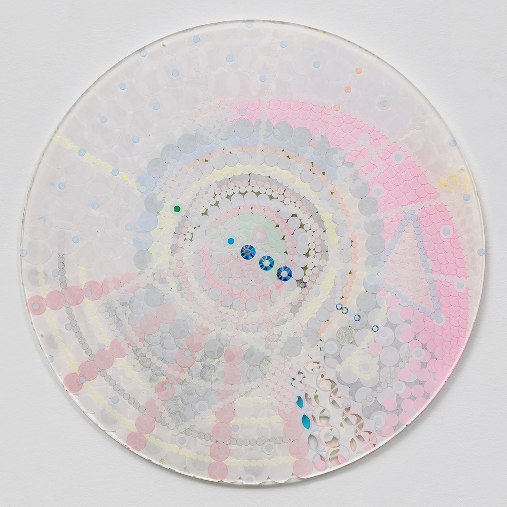 "Fusion Mandala 4, 2014, color coded labels collage on Plexi, 17"" diameter."
