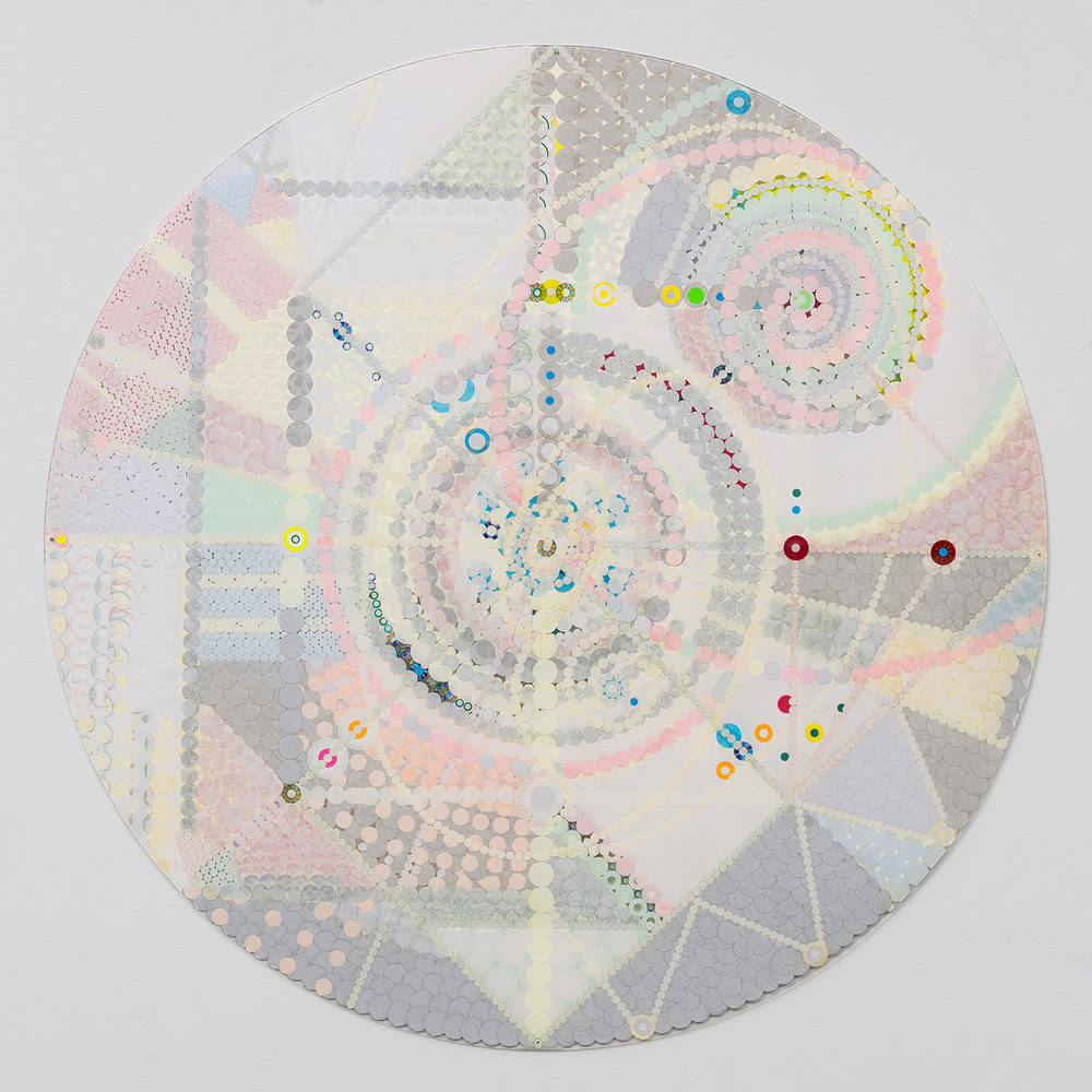 "Fusion Mandala 5, 2015, color coded labels collage on Plexi, 30"" diameter."