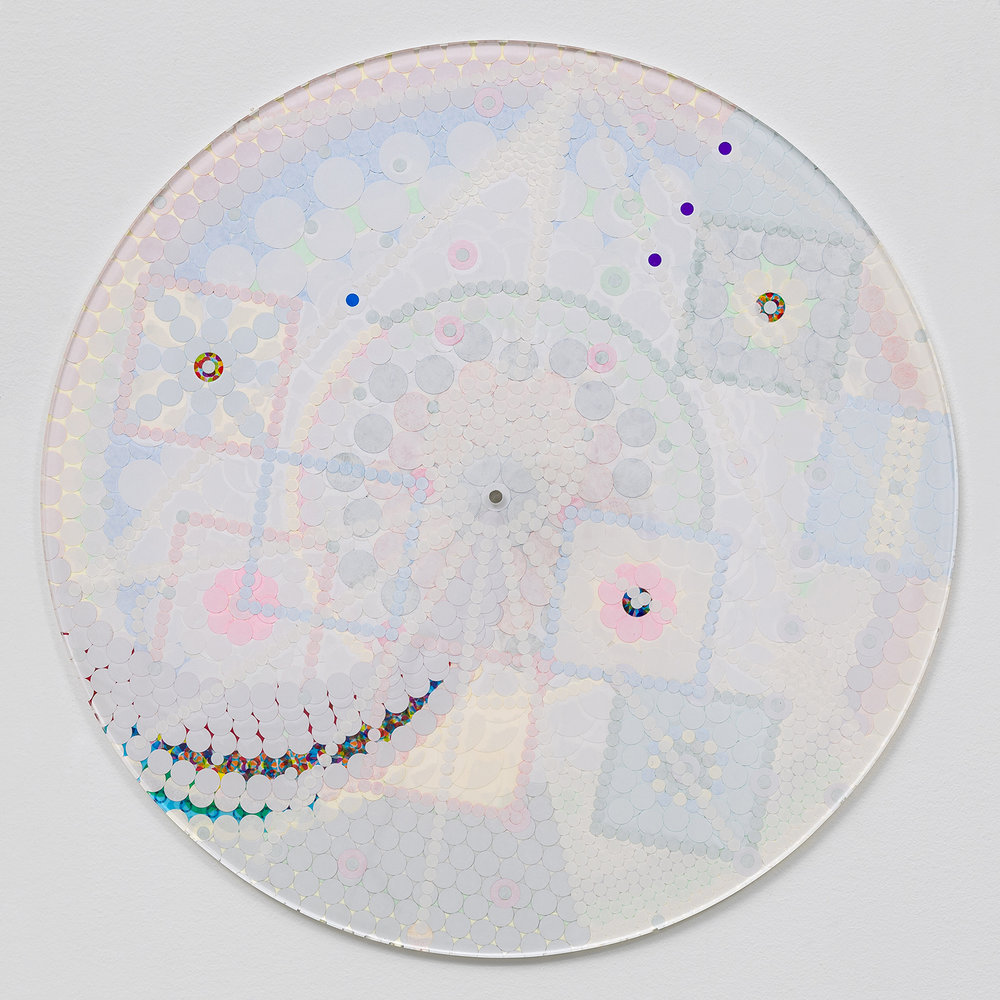 "Fusion Mandala 8, 2016, color coded labels collage on Plexi, 17"" diameter."