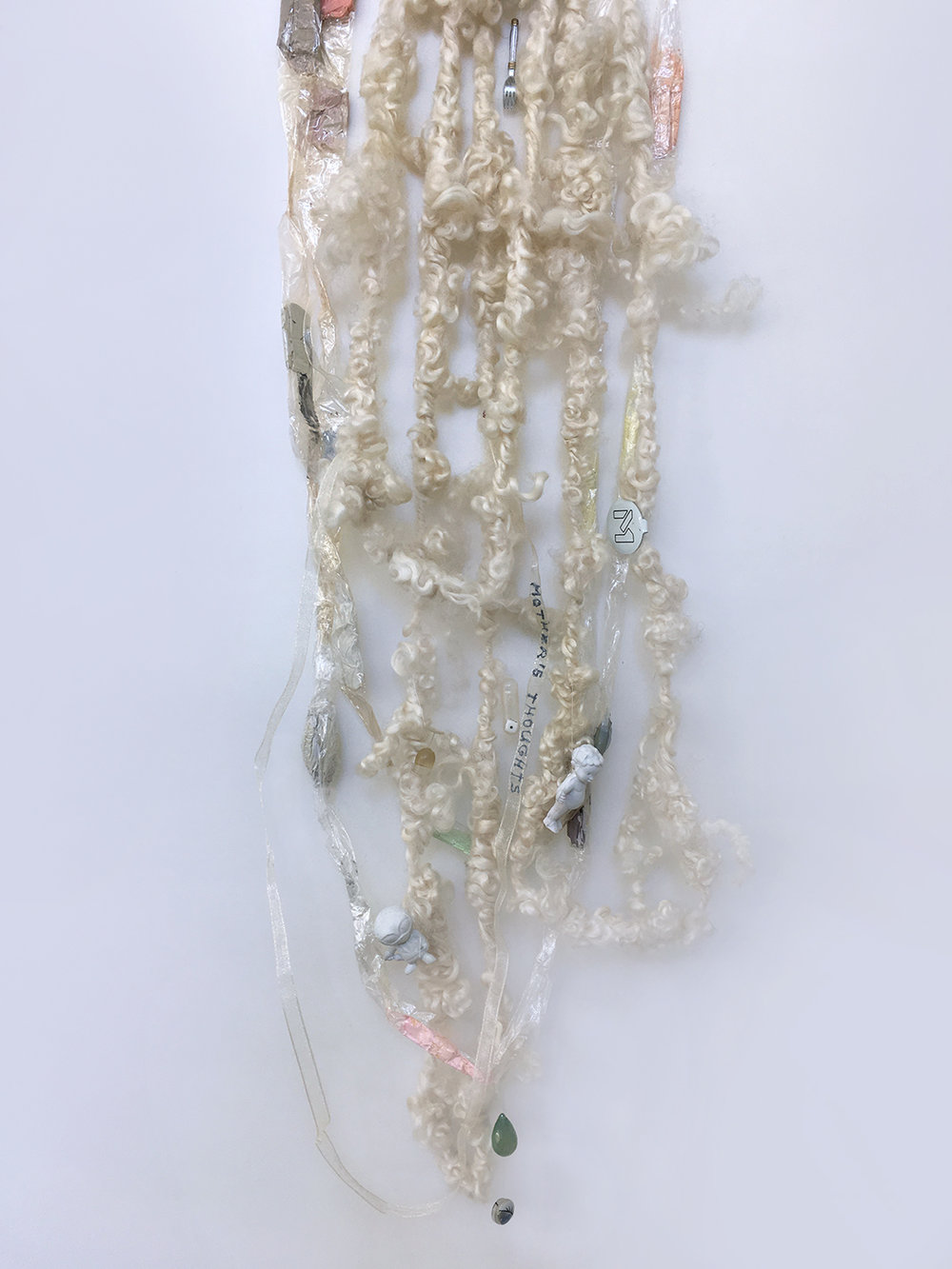 Me as a Goddess, 1, 2008. Detail. Aproximatively 6' long. Sheep wool, plastic, oil paint, ribbon, chalcedony stone and thread.